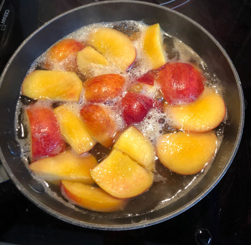 peaches in pan starting to boil