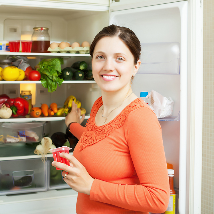 Woman opeing fridge